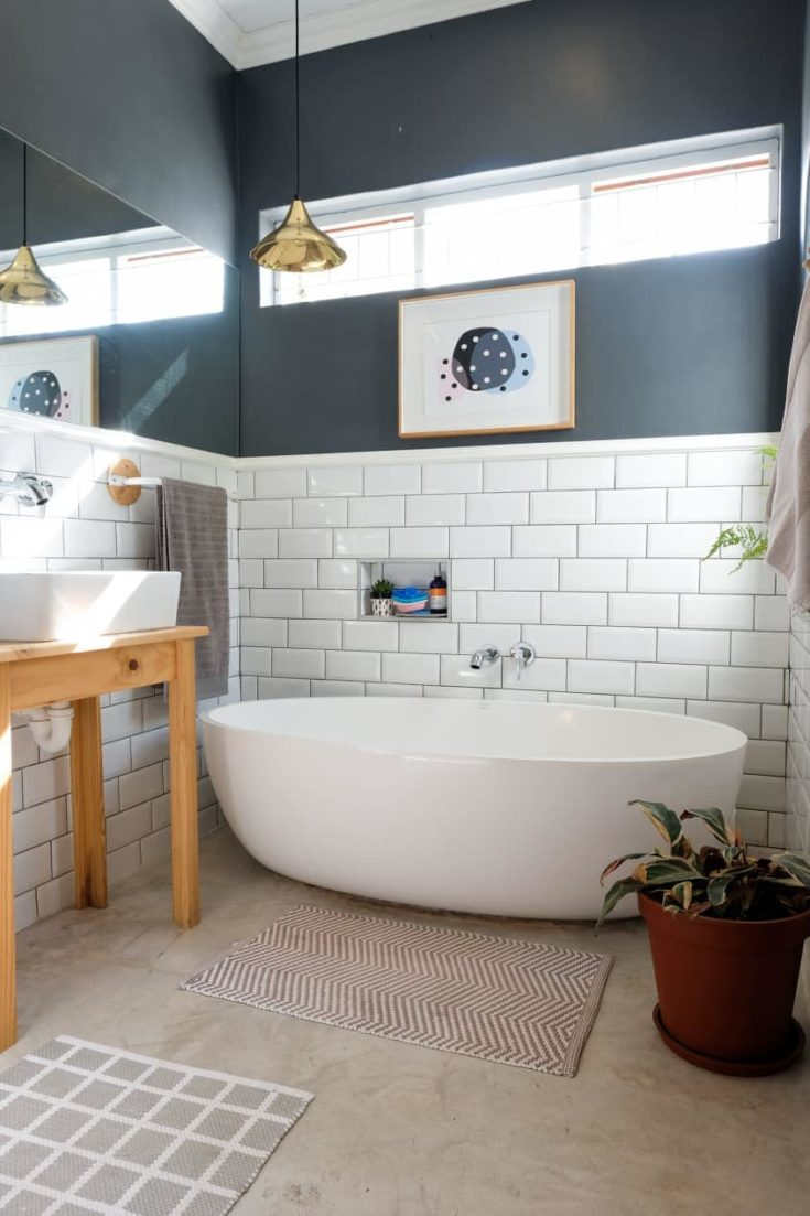 The bathroom was also given a total revamp. They increased the ceiling height and added the window above the bath.