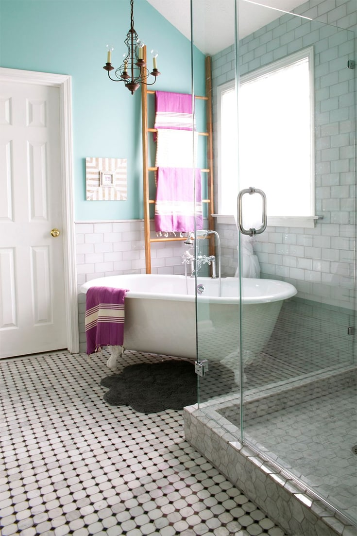 """Three types of tile lend luxury to this modern farmhouse bathroom: on the floors, Carrara Venato 2"""" octagon polished mosaic tile, on the walls, white glass subway tile with rope trim, and finally, on the shower and recessed shelf, Carrara Bianco polished 3"""" hexagon marble mosaic tile."""