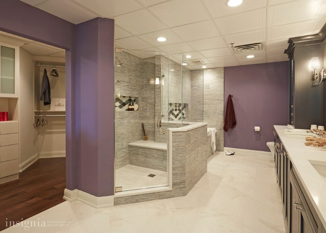 Inspiration for a transitional master gray tile and stone tile porcelain tile drop-in bathtub remodel in Chicago with an undermount sink, gray cabinets, quartz countertops, a two-piece toilet and purple walls