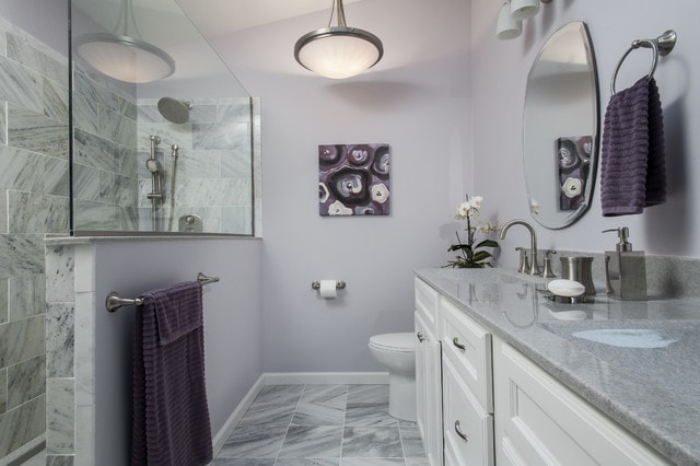 Inspiration for a contemporary bathroom in St Louis with white cabinets, a walk-in shower, engineered stone worktops, grey tiles, stone tiles, purple walls, recessed-panel cabinets and slate flooring.