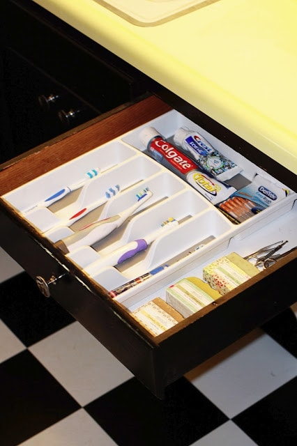a silverware organizer as a family toothbrush holder