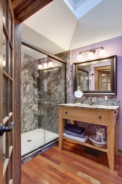 Inspiration for a timeless gray tile medium tone wood floor alcove shower remodel in Seattle with medium tone wood cabinets, purple walls and open cabinets