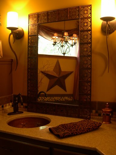 The copper sinks also have the stars embossed in them... The reflection is the spa tub and chandelier above..