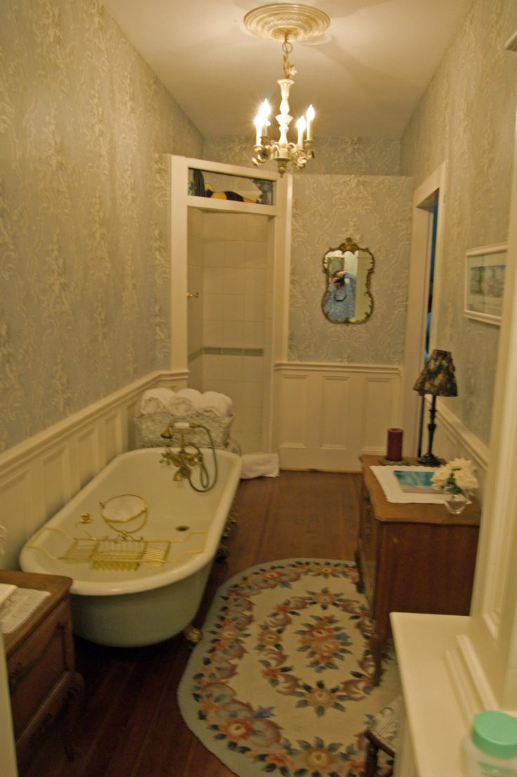 """this is only half the bathroom..the ball and claw victorian tub is twice, and every inch of this place is decorated in high end victorian stuff. the back """"wall"""" isnt a wall at all, but the entrance to a full stand up shower with marble seat and copper fixtures. It has one of those big rain showerheads.. It also has two chandeliers in just this bathroom. There are chandeliers all over the hosue. its amazingly beautiful"""