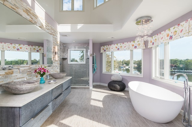 Bathroom - mid-sized transitional master gray tile and stone tile porcelain tile and gray floor bathroom idea in New York with flat-panel cabinets, purple walls, a vessel sink, granite countertops and gray cabinets