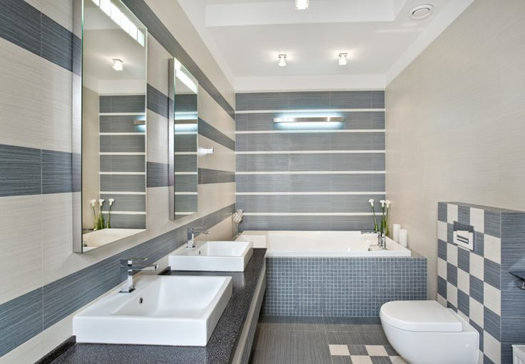 Modern bathroom in blue and gray tones with mosaic on wide angle view