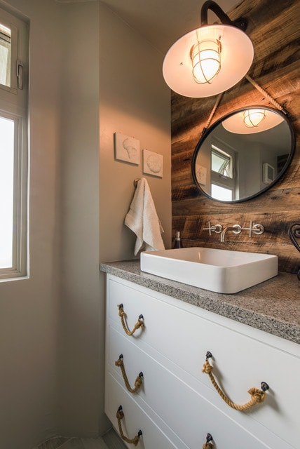 Inspiration for a mid-sized coastal 3/4 bathroom remodel in San Diego with a vessel sink, flat-panel cabinets, white cabinets, beige walls, quartz countertops and gray countertops