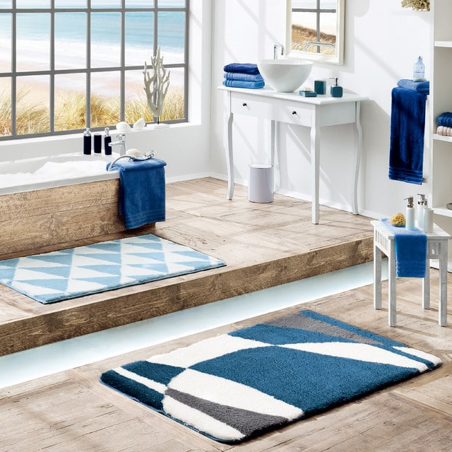 Contemporary blue bathroom featuring a selection of our bath rugs and bath towels.