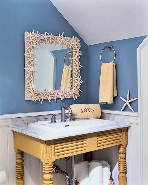 Beach style bathroom photo in Boston with marble countertops and a drop-in sink