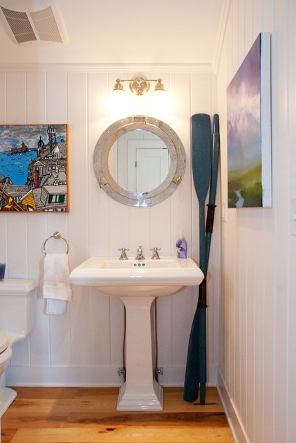 Example of a beach style bathroom design in Boston with a pedestal sink