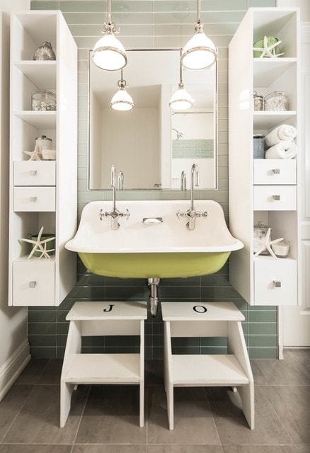Example of a beach style kids' green tile and glass tile bathroom design in New York with white cabinets and a trough sink