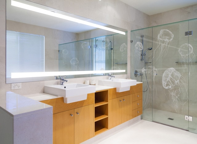 Example of a trendy beige tile alcove shower design in Sydney with a drop-in sink, flat-panel cabinets, medium tone wood cabinets and beige walls