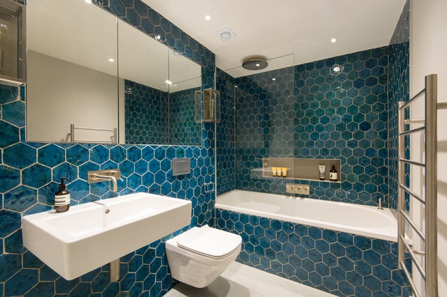 Bathroom - contemporary 3/4 blue tile concrete floor and gray floor bathroom idea in London with a wall-mount toilet, white walls and a wall-mount sink