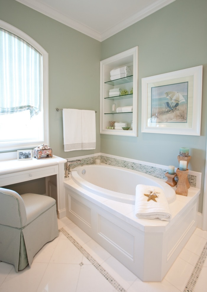 Drop-in bathtub - traditional white tile drop-in bathtub idea in Houston with white cabinets
