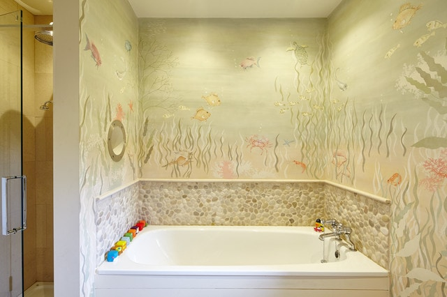 Inspiration for a tropical kids' drop-in bathtub remodel in Other with multicolored walls