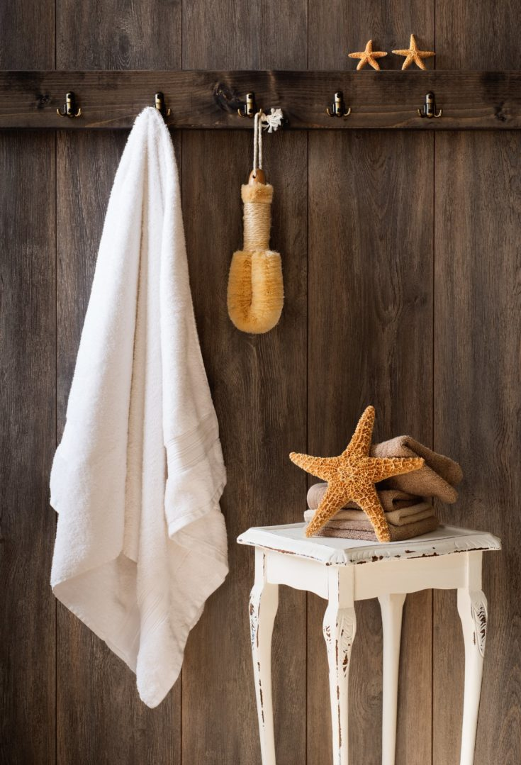 Bathroom interior with hanging white towel and starfish
