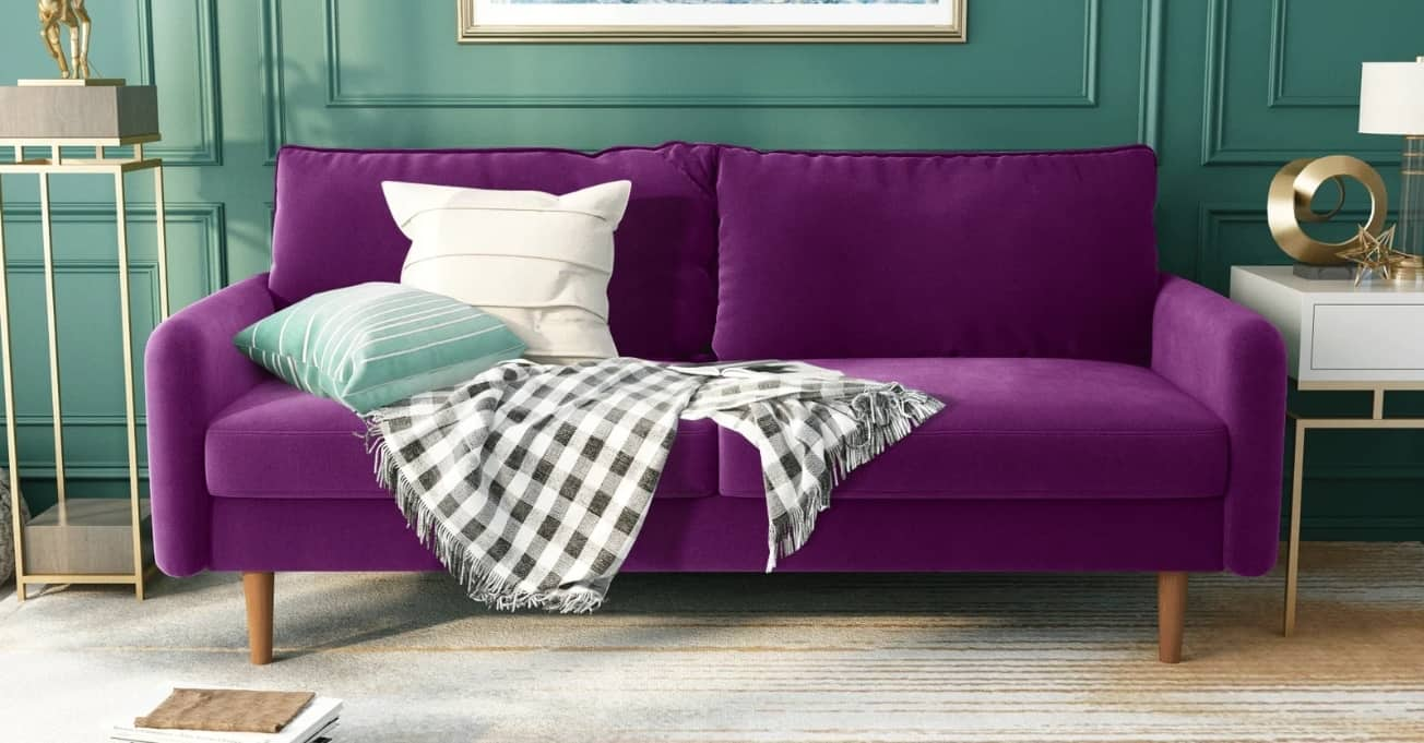 Purple couch with throw pillows