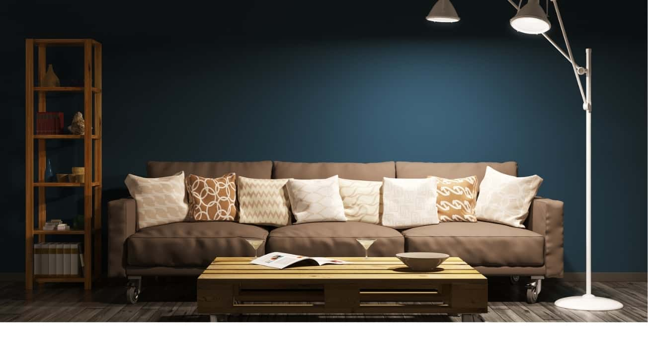 Brown sofa with pillows on top.