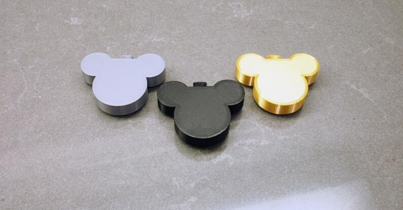 3 mickey mouse decor in gray background