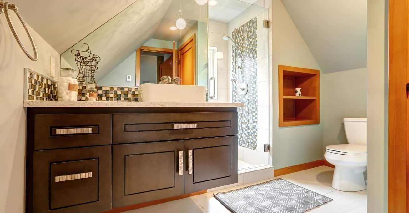 Small white bathroom with storage