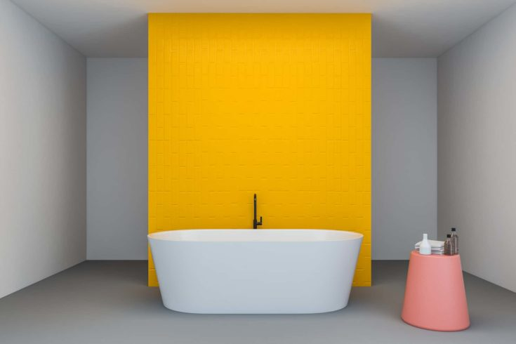 Interior of bright bathroom with white and yellow walls