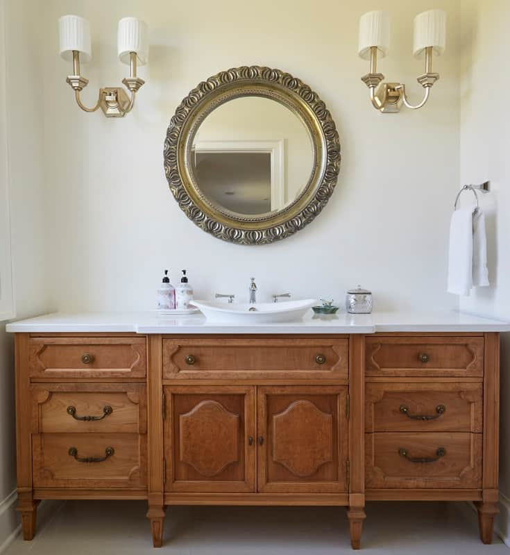 Inspiration for a large cottage gray floor powder room remodel in Chicago