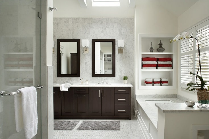 Example of a transitional white tile bathroom design in New York with shaker cabinets