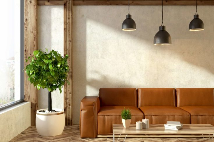 Beige minimalistic living room interior with panoramic windows, a brown leather sofa