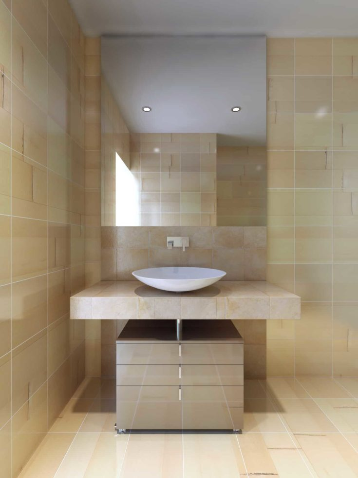 Contemporary style bathroom. Large mirror, tiled walls, flooring and countertop navajo white color.