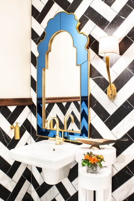Mid-sized eclectic stone tile and black and white tile powder room photo in San Francisco with a wall-mount sink