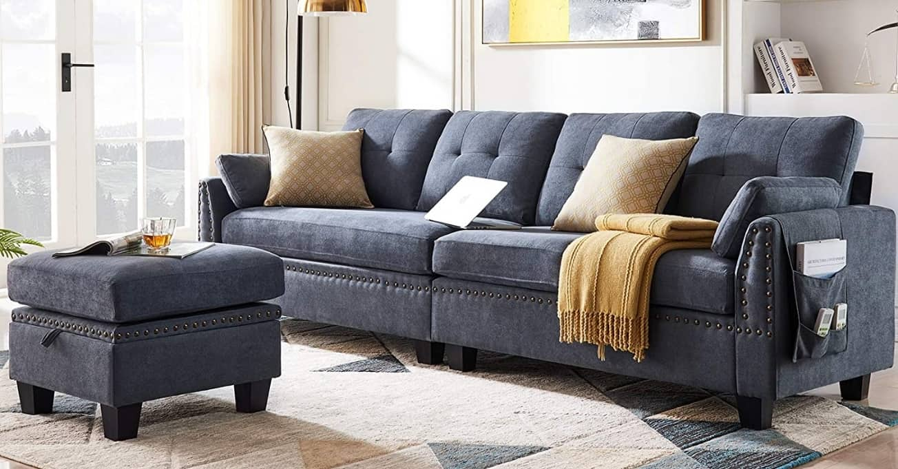 Beautiful sectional gray couch and yellow pillows.