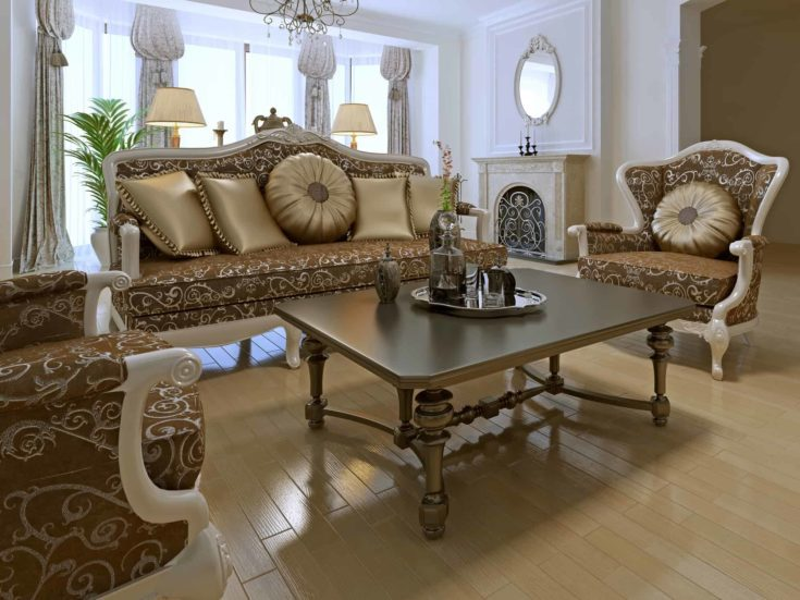 Elegant lounge room in private house with using of antique furniture of golden colors.