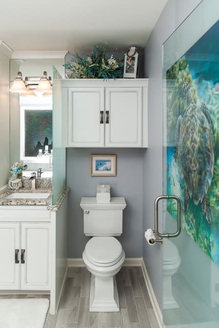 Inspiration for a small coastal master porcelain tile and gray floor drop-in bathtub