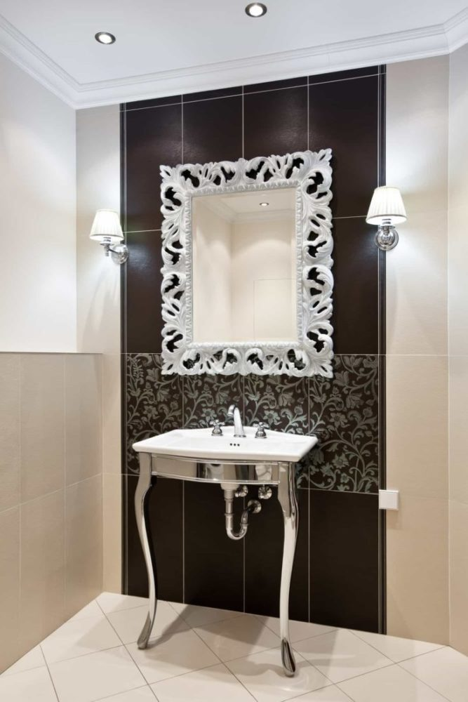 Interior of luxury domestic room with expensive framed mirror and sink
