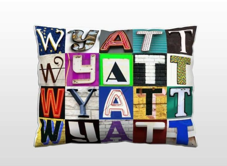 Personalized Pillow featuring WYATT in photos of sign letters