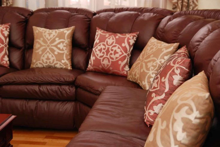 pillows on a brown leather sofa