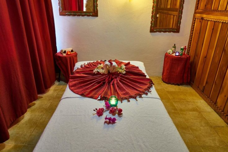 Warm Flowers and Drapes massage room