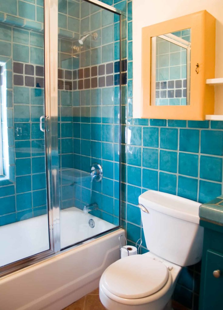 Turquoise and blue tile work in a bathroom