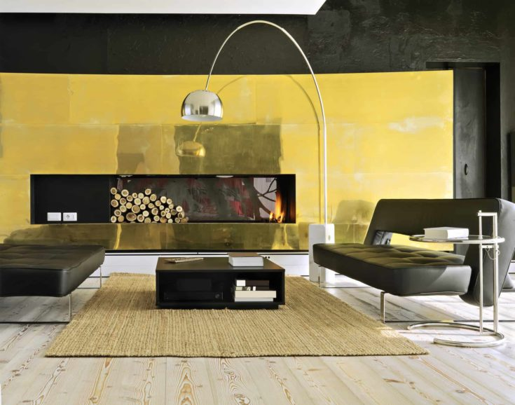 two modern leather sofa near to fireplace in the modern living room