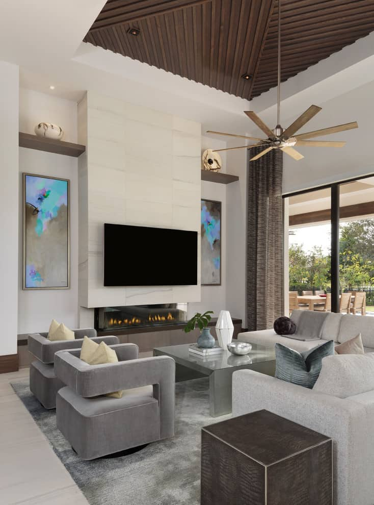 Example of a large minimalist open concept porcelain tile and beige floor living room design