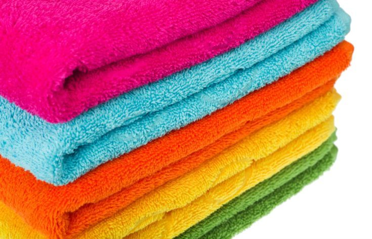 stacked colorful towels on a white background